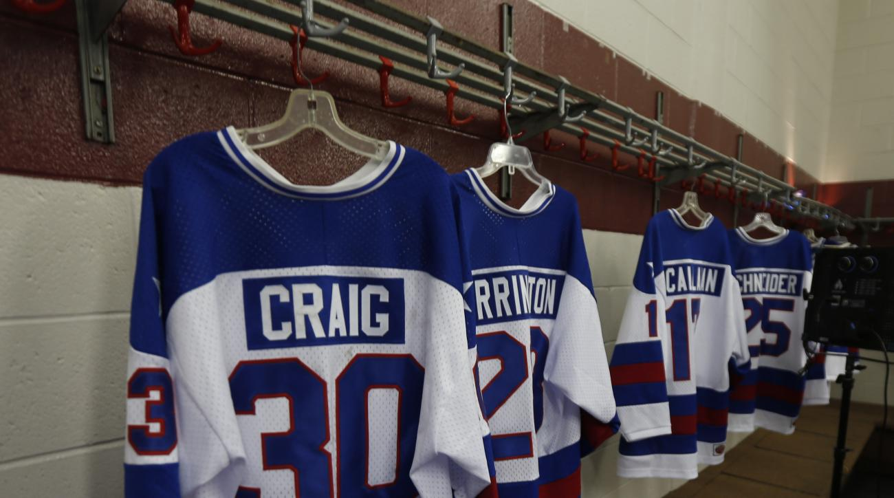 The jersey of goalie Jim Craig from the 1980 U.S. Olympic ice hockey team hangs in a locker room at Herb Brooks Arena on Saturday, Feb. 21, 2015, in Lake Placid, N.Y. Thirty-five years after the team's stunning gold medal at the 1980 Lake Placid Winter Ol