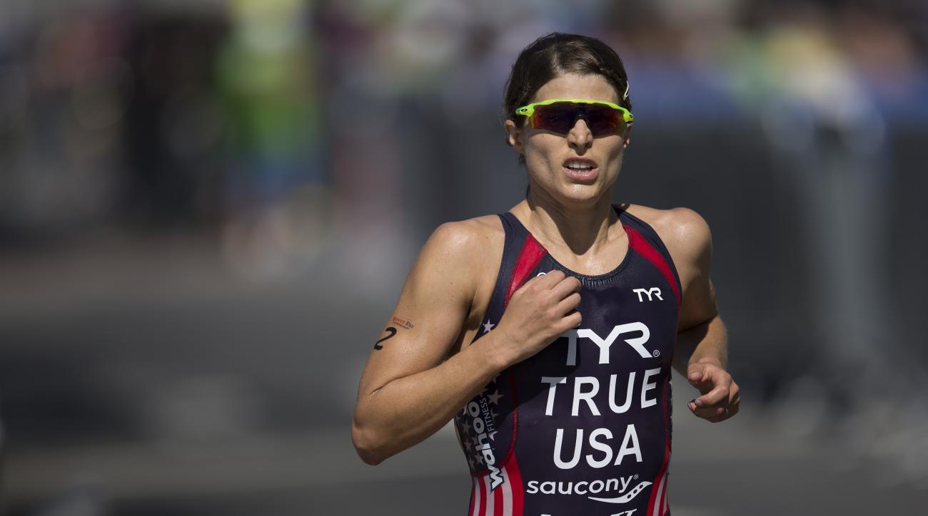 Sarah True of the United States competes during the women's triathlon ITU World Olympic Qualification Event, in Rio de Janeiro, Brazil, Sunday, Aug. 2, 2015. The World Olympic Qualification is a test event for the Rio 2016 Olympics. (AP Photo/Leo Correa)