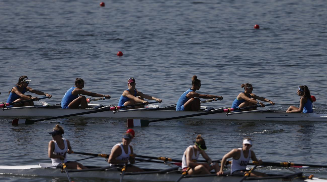 Teams of rowers from Italy, top, and the U.S., bottom, practice for the 2015 World Rowing Junior Championships on  Rodrigo de Freitas lake in Rio de Janeiro, Brazil, Tuesday, Aug. 4, 2015. The head of the governing body of world rowing says he will ask fo