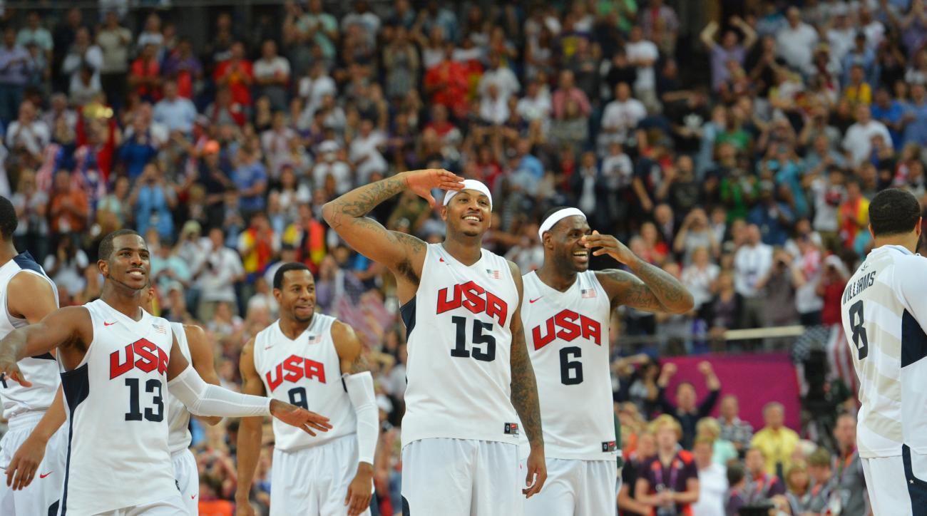 LONDON, ENGLAND - AUGUST 12: Chris Paul #13, Carmelo Anthony #15 and LeBron James #6 of the US Men's Senior National Team celebrates against Spain during their Men's Gold Medal Basketball Game on Day 16 of the London 2012 Olympic Games at the North Greenw