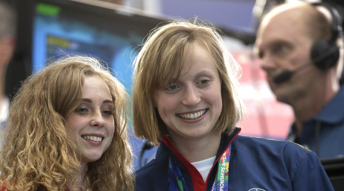United States' swimmer Katie Ledecky, right, poses for a photo with fans ahead of the final night of racing at the Swimming World Championships in Kazan, Russia, Sunday, Aug. 9, 2015. Ledecky won five gold medals at the 2015 championships. (AP Photo/Micha