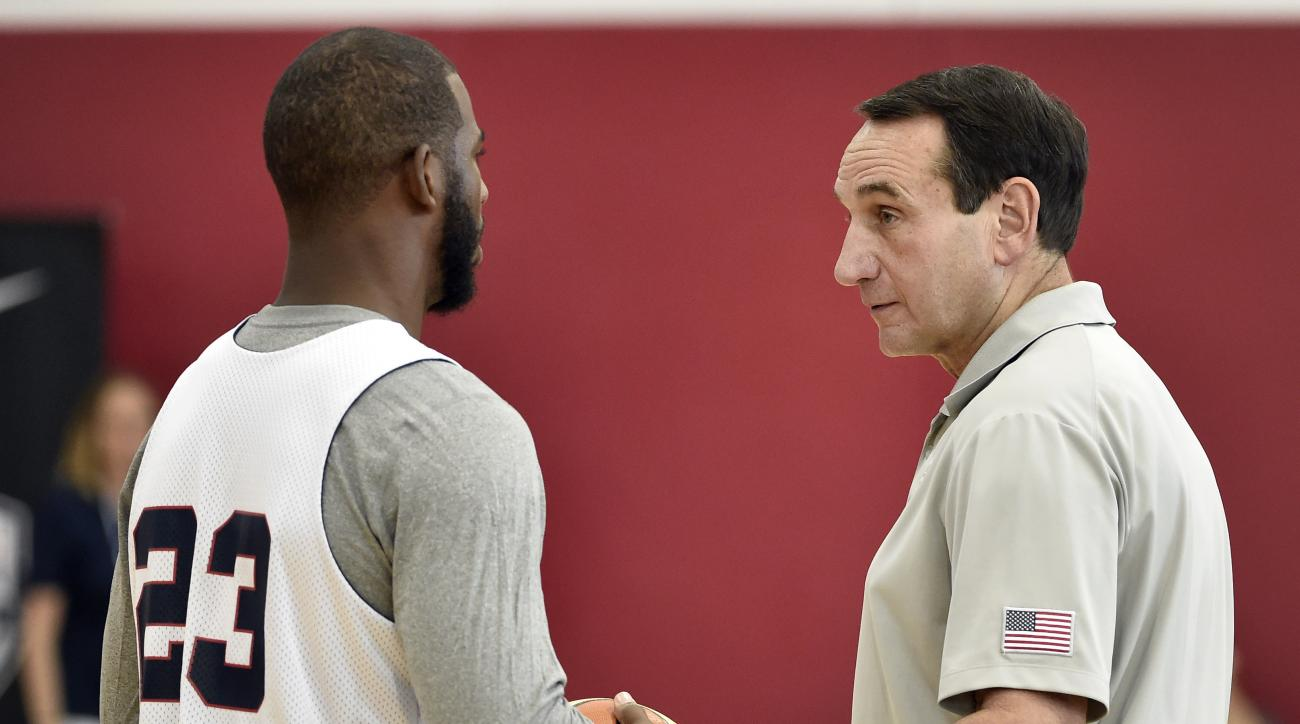U.S men's basketball coach Mike Krzyzewski, right, speaks with Chris Paul during the team's minicamp Tuesday, Aug. 11, 2015, in Las Vegas. (AP Photo/David Becker)