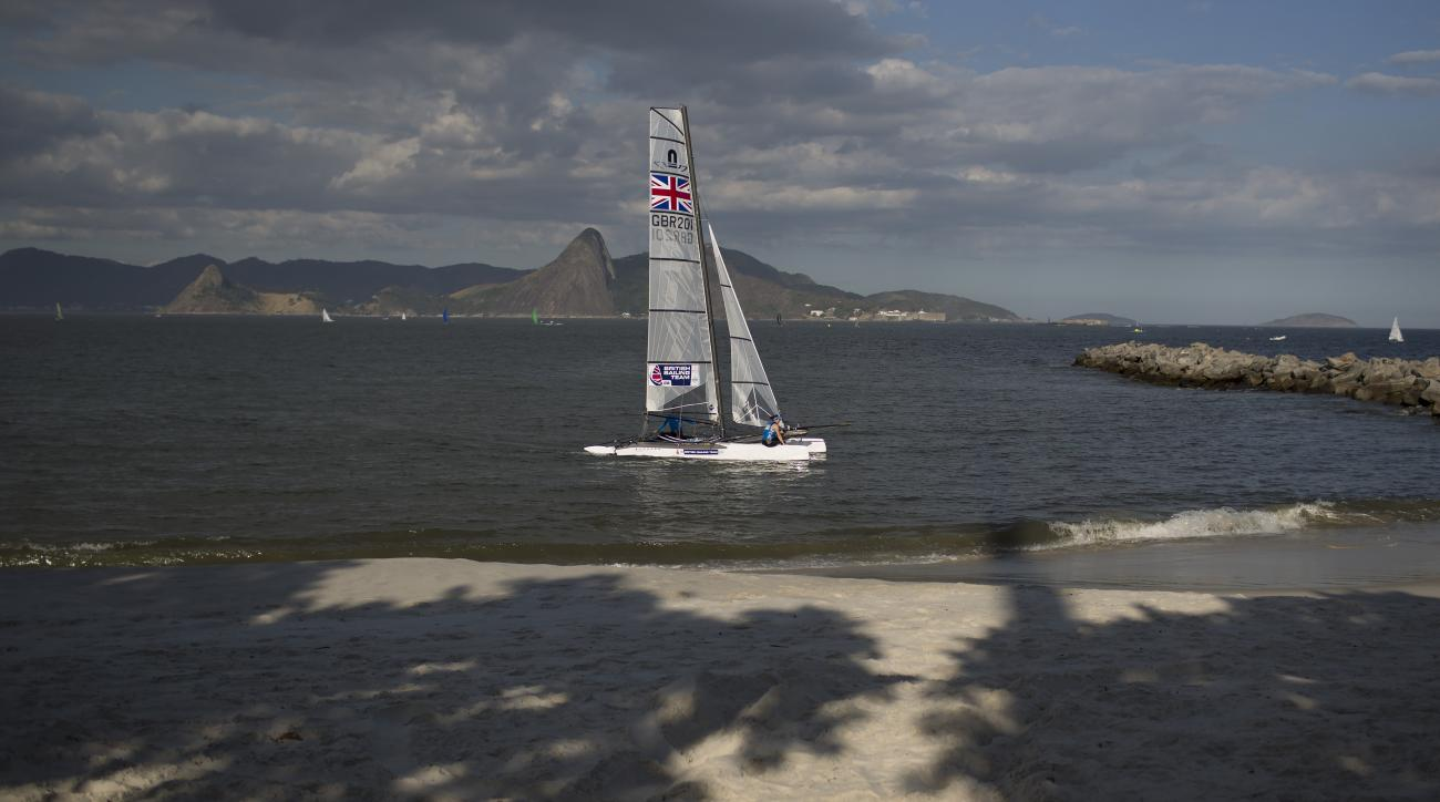 Nacra 17 class athletes from Great Britain arrive to Flamengo beach practicing one day before the sailing test event ahead of the Rio 2016 Olympic Games in Guanabara Bay in Rio de Janeiro, Brazil, Friday, Aug. 14, 2015. Bruce Gordon, the WHO's coordinator
