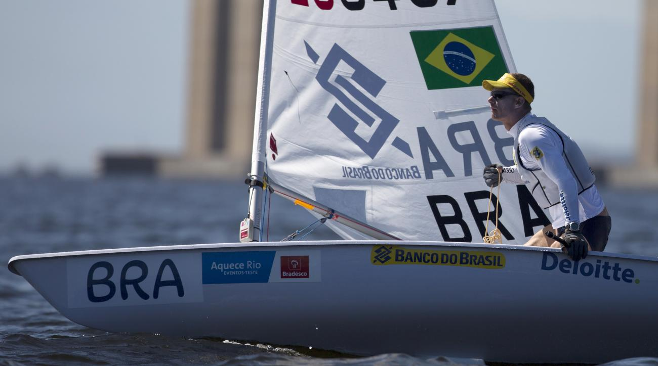 Brazil's Robert Scheidt prepares for a sailing test in the One Person Dinghy Men's Laser class event, ahead of the Rio 2016 Olympic Games, in Guanabara Bay in Rio de Janeiro, Brazil, Saturday, Aug. 15, 2015. (AP Photo/Leo Correa)