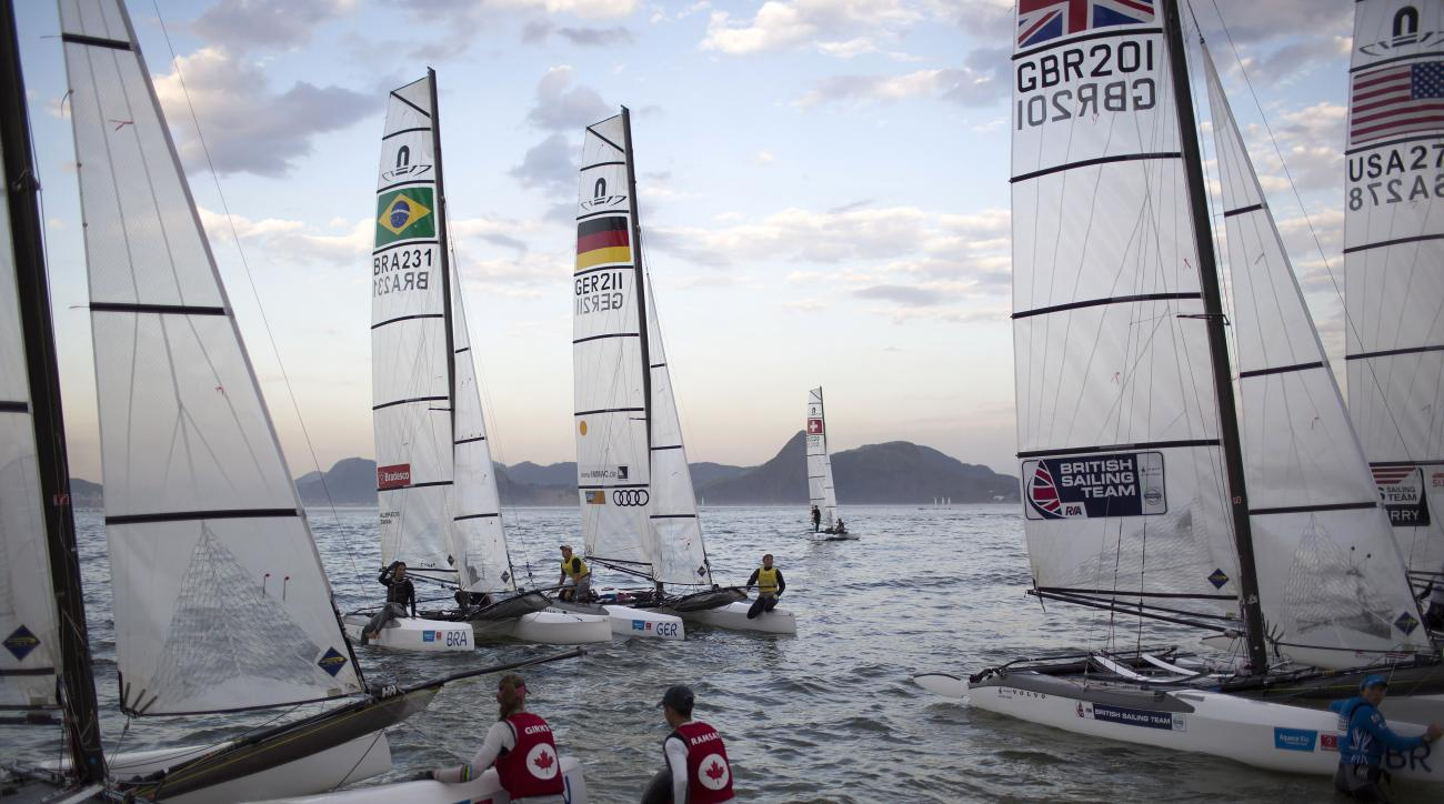 Athletes from the Nacra 17 Mixed Multihull class return to Flamengo beach after competing in a sailing test event for the Rio 2016 Olympic Games in Guanabara Bay, Rio de Janeiro, Brazil, Wednesday, Aug. 19, 2015. Much of the focus at the Olympic sailing t