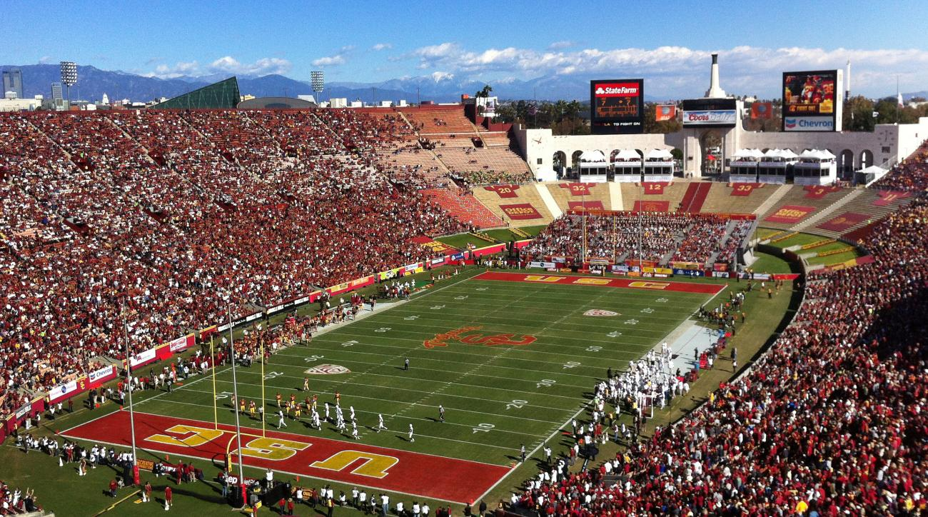 FILE - In this Nov. 11, 2012, file photo, Southern California pays against Arizona State in an NCAA college football game at Los Angeles Memorial Coliseum. Los Angeles has agreed to a deal with the U.S. Olympic Committee that will make it America's bid ci