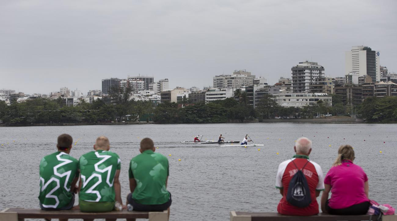 People watch the men's 1000m Canoe Single semi-final during the International Canoe Sprint Challenge on Rodrigo de Freitas Lagoon in Rio de Janeiro, Brazil, Friday, Sept. 4, 2015. Canoeists at the Olympic test event complained Friday about the polluted wa