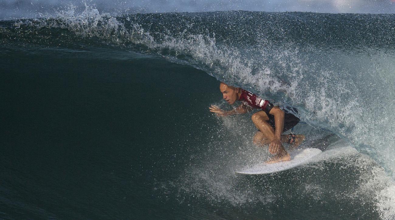 FILE - In this May 12, 2015 file photo, U.S. surfer Kelly Slater competes in the 2015 Oi Rio Pro World Surf League competition at Barra da Tijuca beach in Rio de Janeiro, Brazil. (AP Photo/Leo Correa, File)