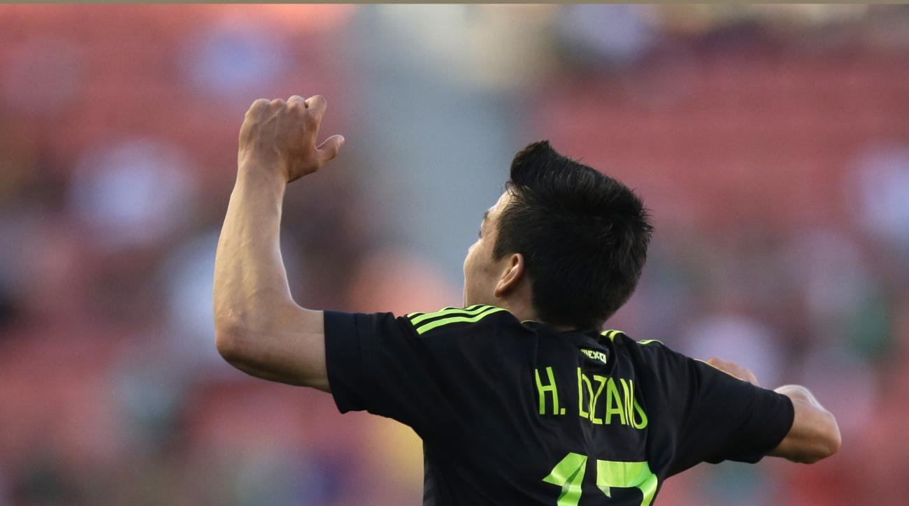 Mexico forward Hirving Lozano (17) leaps after scoring against Canada during the second half of a CONCACAF men's Olympic semifinal soccer match Saturday, Oct. 10, 2015, in Sandy, Utah. Mexico won 2-0. (AP Photo/Rick Bowmer)