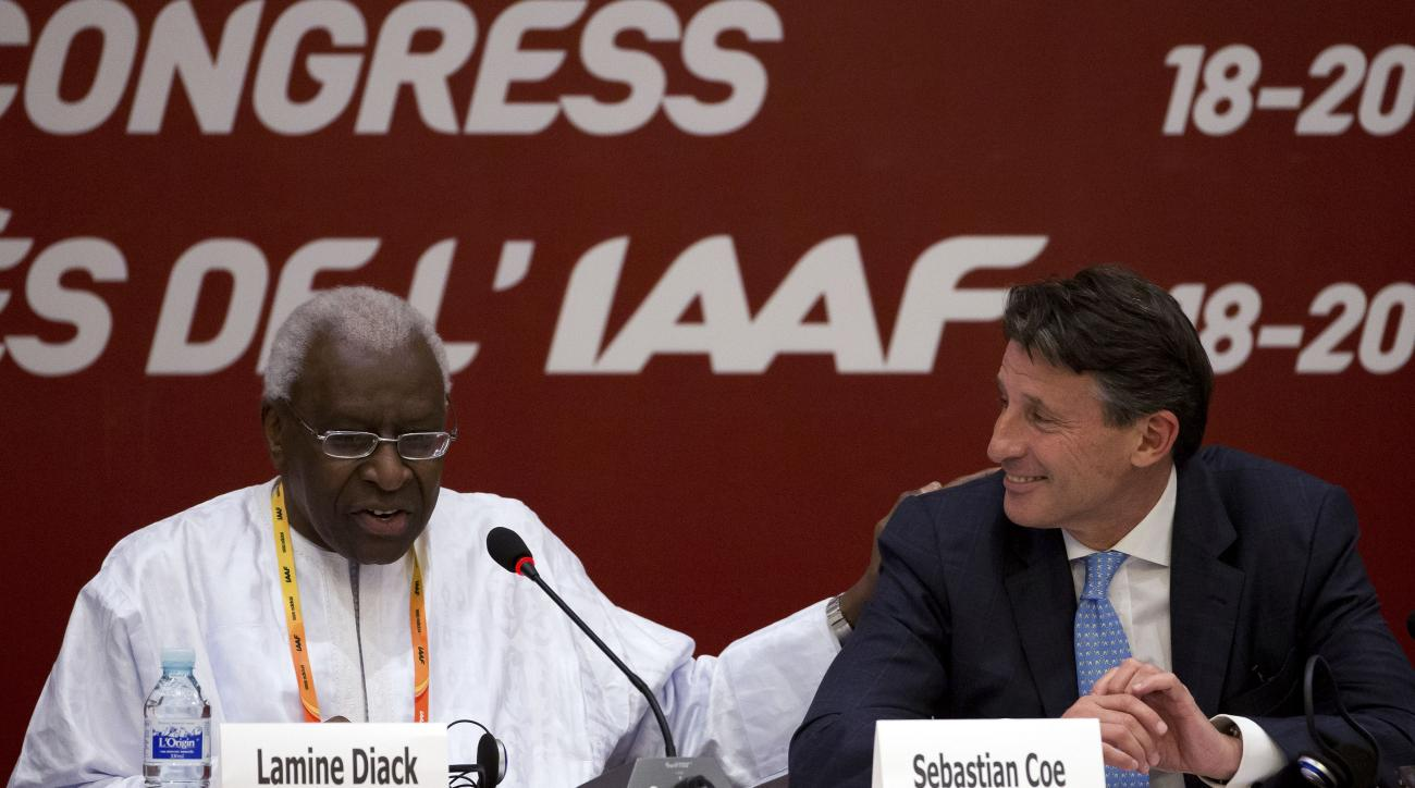 FILE - In this Aug.19, 2015 file photo, International Association of Athletics Federations outgoing president Lamine Diack, left, speaks next to newly elected president Sebastian Coe during a press briefing at the IAAF Congress at the National Convention