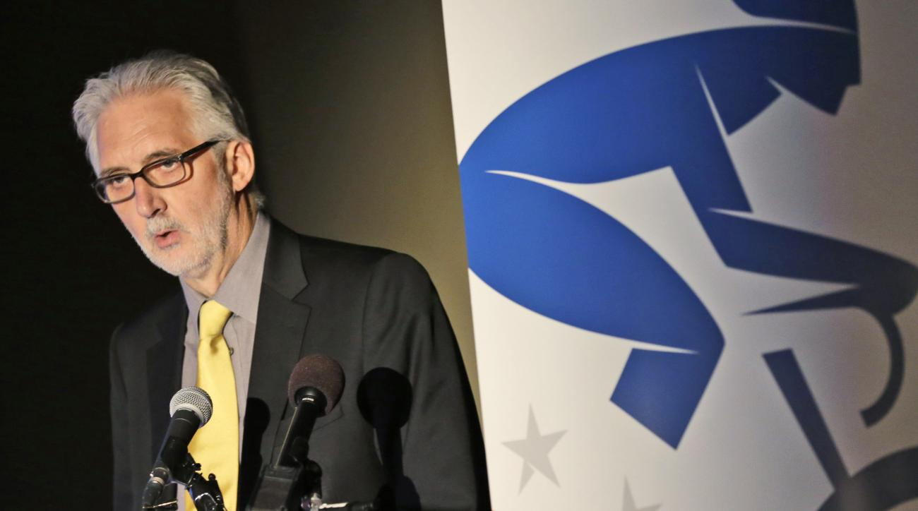 FILE - In this Tuesday, Feb. 25, 2014 file photo,  International Cycling Union President Brian Cookson gestures during a press conference announcing courses for the 2015 World Cycling Championships in Richmond, Va. After months of negotiations, cycling's