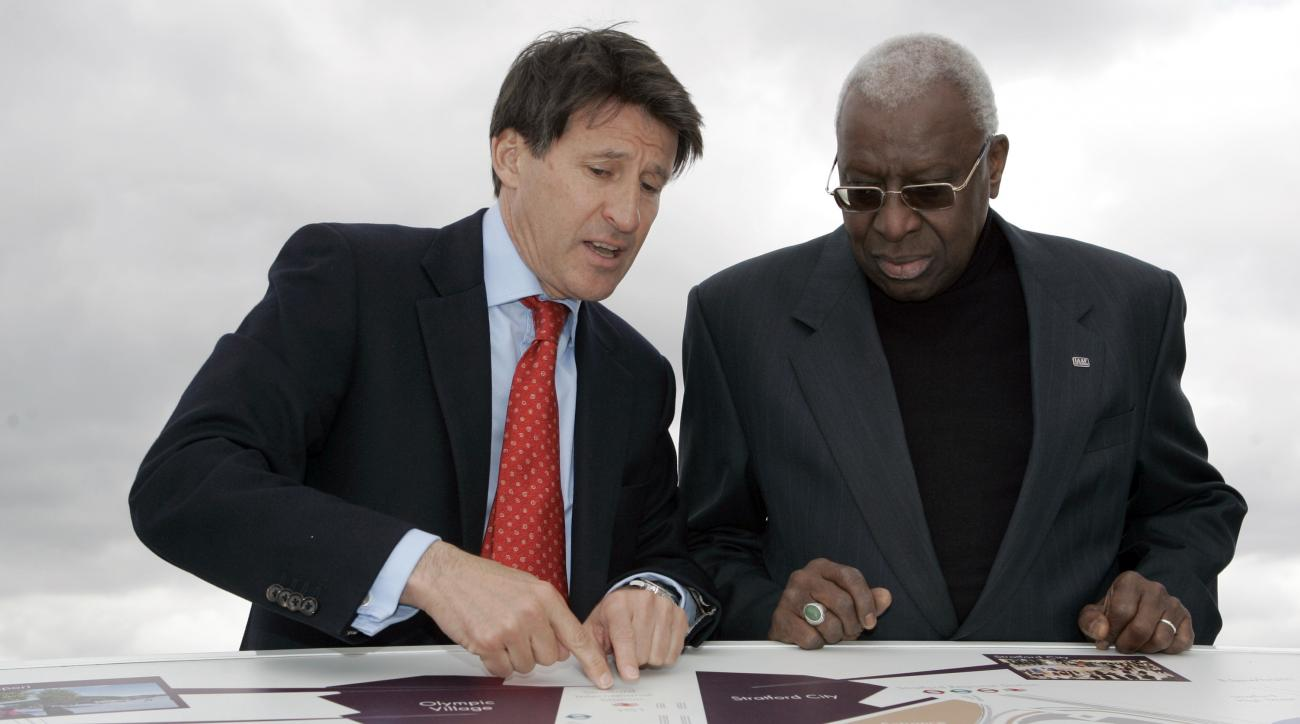 FILE - In this May 15, 2009 file photo Sebastian Coe Chairman of the London 2012 Organizing Committee of the Olympic Games, left, talks with Lamine Diack President of the IAAF as they look at a map of the site of the London 2012 Olympics in  London. Forme