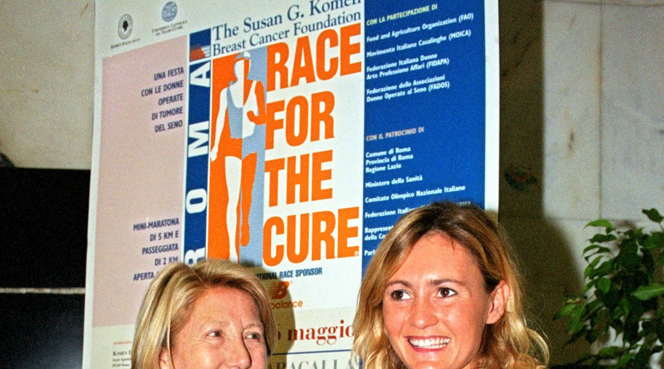 FILE - In this Thursday, May 3, 2001 file photo, Italian fashion designer Franca Fendi, left, and Italian Olympic fencing medallist Diana Bianchedi attend a press conference in Rome to present the Race for the Cure. Two-time Olympic fencing gold medalist