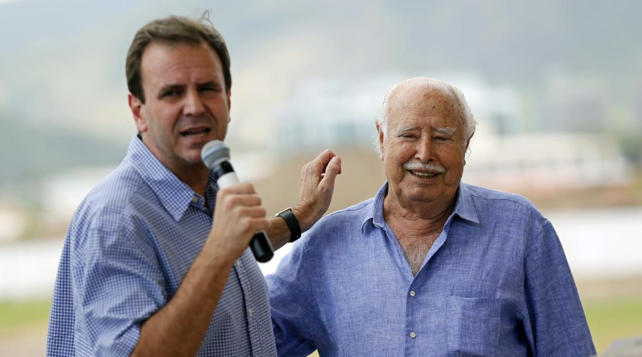 Rio de Janeiro Mayor Eduardo Paes, left, and billionaire developer Pasquale Mauro attend a ceremony at the Olympic Golf Course in Rio de Janeiro, Sunday, Nov. 22, 2015. Paes spent 15 minutes defending the course, built in the wealthy neighborhood of Barra