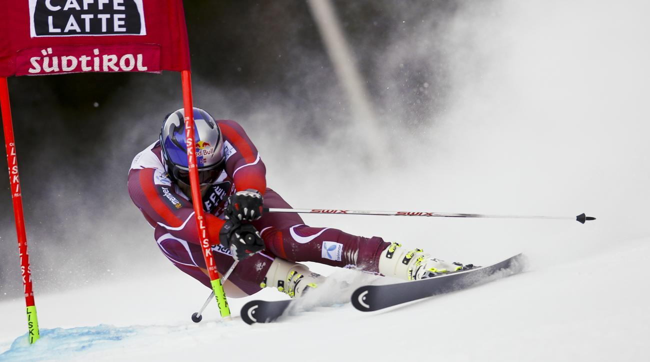 Norway's Aksel Lund Svindal speeds down the course during the first run of an alpine ski, men's World Cup giant slalom, in Alta Badia, Italy, Sunday, Dec. 20, 2015. (AP Photo/Marco Trovati)