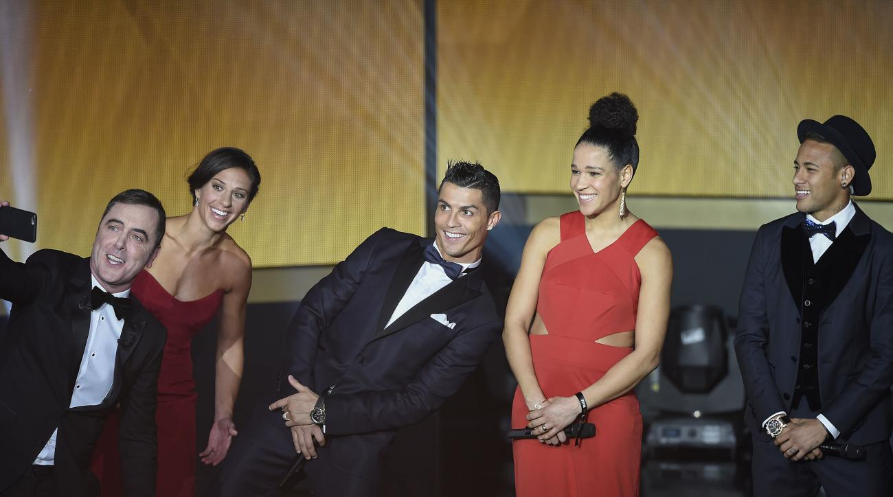 James Nesbitt, presenter of the show, takes a selfie with Carli Lloyd of the USA, Portugal's Cristiano Ronaldo, Germany's Celia Sasic and Brazil's Neymar, from left, during the FIFA Ballon d'Or awarding ceremony at the Kongresshaus in Zurich, Switzerland,