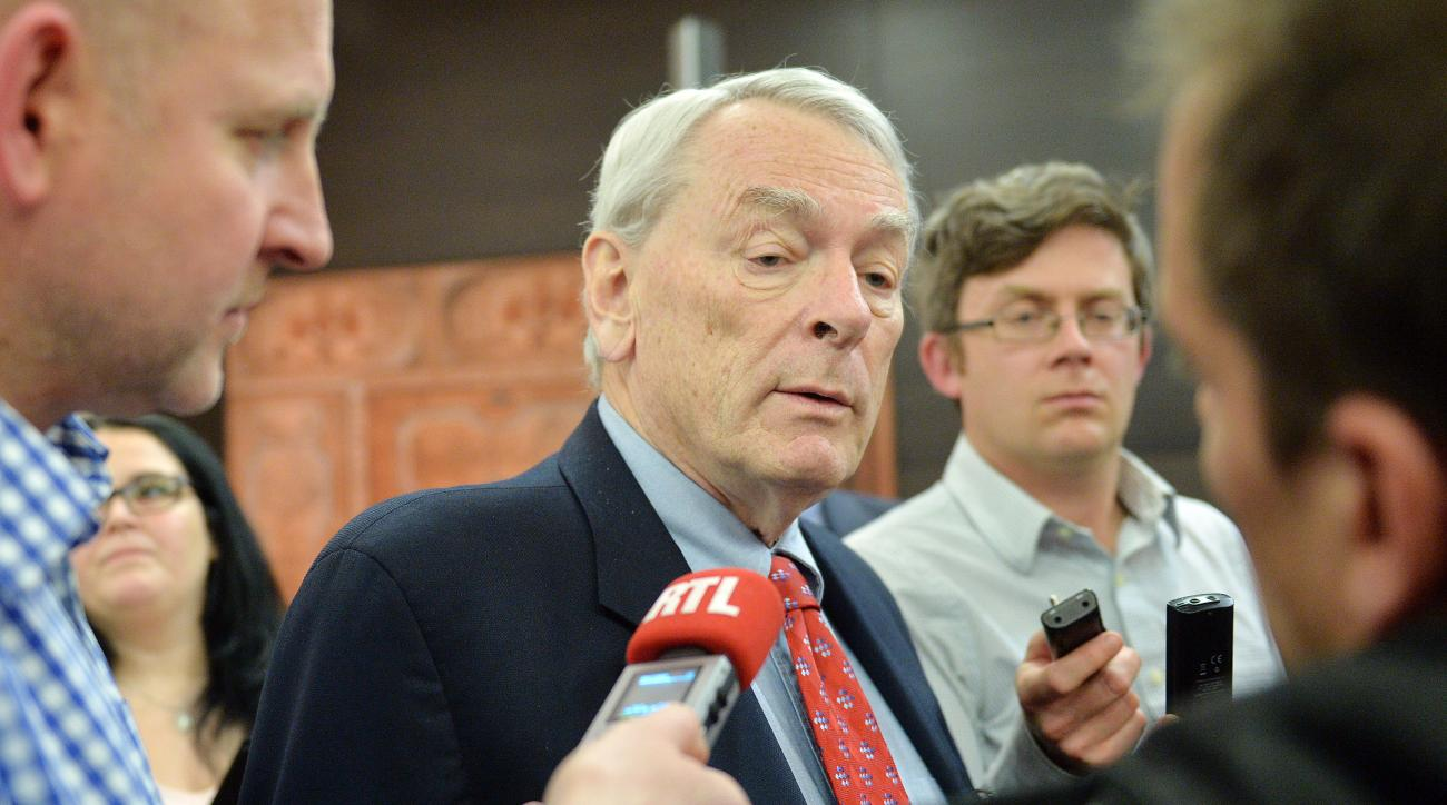 Canadian Richard Pound, center,Chairman of WADA's (World Anti-Doping Agency) Independent Commission (IC), answers questions after he presented the findings of his Commission's Report surrounding allegations of doping in sport, during a press conference in