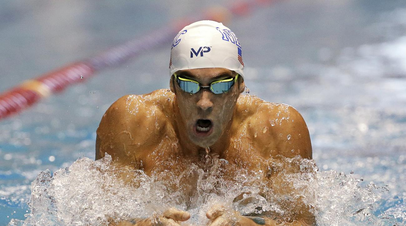 FILE - In this Dec. 3, 2015, file photo, Michael Phelps swims the breaststroke leg of the men's 200-meter individual medley in a preliminary race at the U.S. Winter Nationals swimming event in Federal Way, Wash.  Phelps moved to suburban Phoenix a few mon
