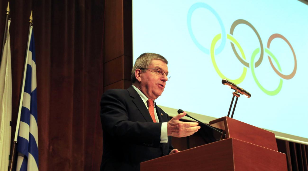 "IOC President Thomas Bach speaks during a sporting awards ceremony of Greek athletes in Athens on Wednesday, Jan. 27, 2016. Bach says he is confident the Rio Olympics will ""overwhelm"" the world, despite the host country's major financial crisis. (AP Photo"