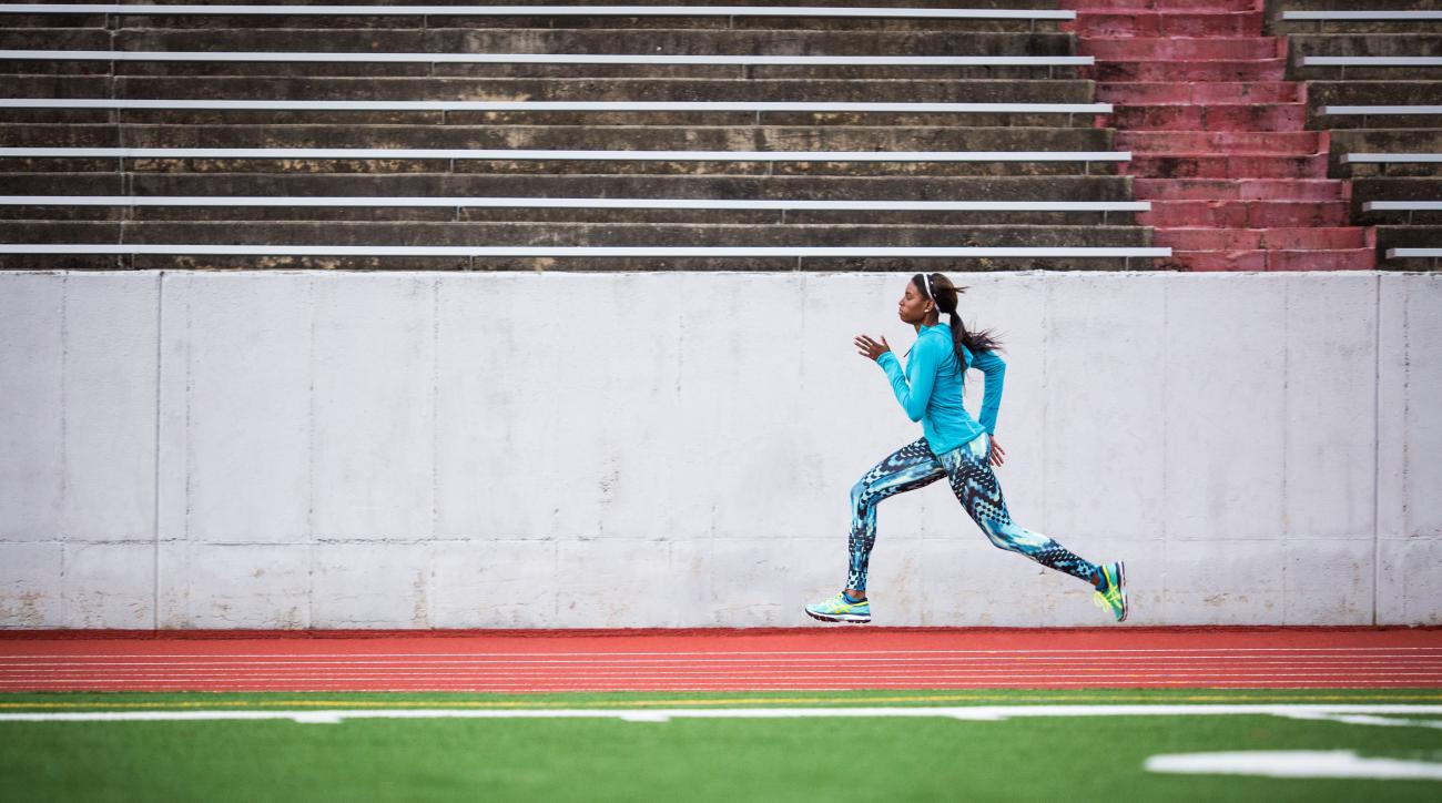 In this image taken in December 2015, and provided by ASICS America, American sprinter Candace Hill runs at Rockdale County High School Track in Conyers, Ga. Hill's favorite subject in high school is U.S. history. Certainly appropriate, since the 16-year-