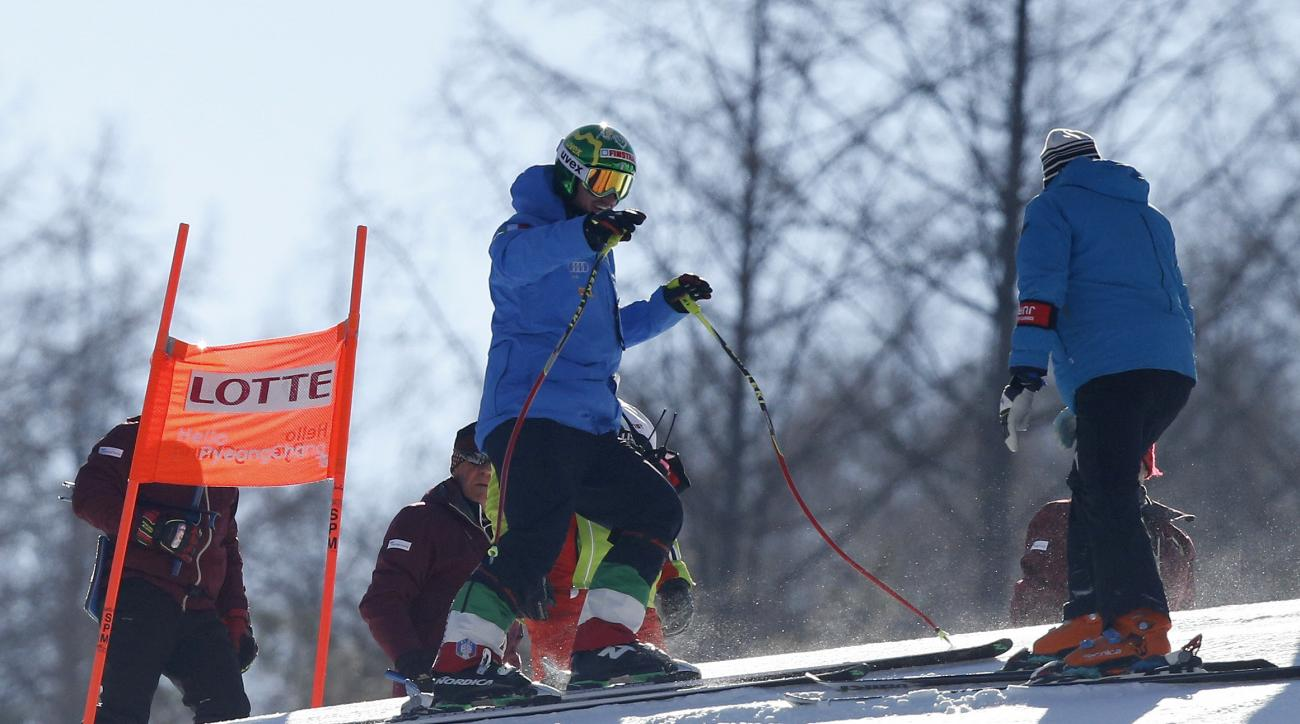 Italy's Dominik Paris, left, talks with his team officer during a free skiing session following the cancellation of the first training run for test event of the Pyeongchang 2018 Winter Olympics at the Jeongseon Alpine Centre in Jeongseon, Wednesday, Feb.