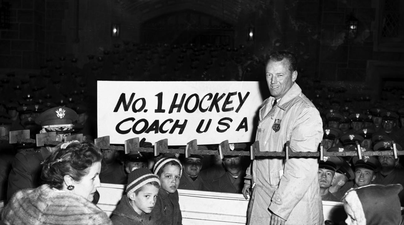 FILE - In this Feb. 29, 1960 file photo, U.S. Olympic Hockey coach Jack Riley is welcomed back to U.S. Military Academy at West Point, N.Y.  Riley, a former Army hockey coach who won guided the U.S. team to its first Olympic gold medal in 1960, has died.