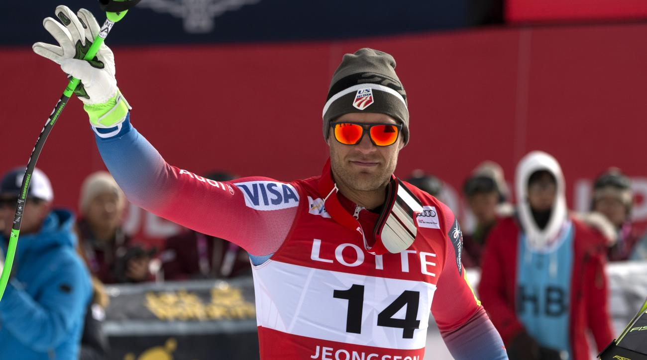 Third-place finisher Steven Nyman of the United States waves as he is introduced at an award ceremony following a men's World Cup downhill race, also a test event for the Pyeongchang 2018 Winter Olympics, at the Jeongseon Alpine Centre in Jeongseon, South