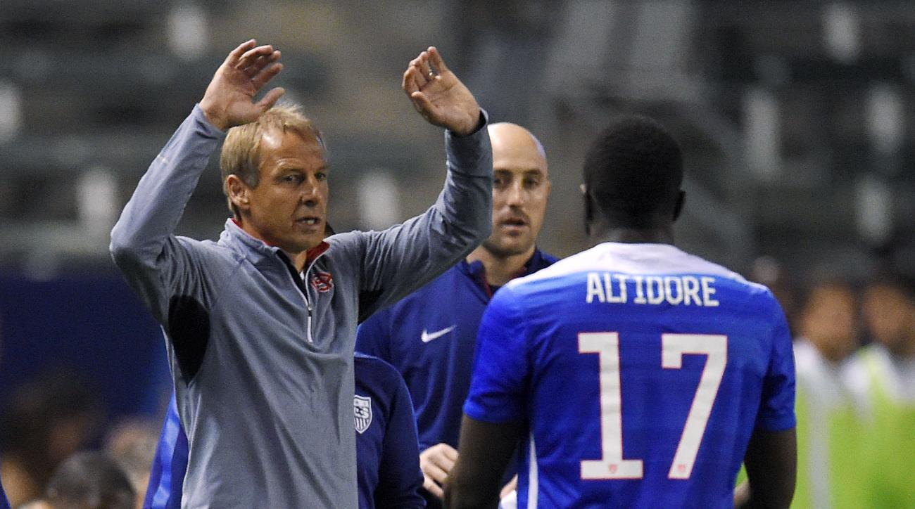 United States coach Jurgen Klinsmann, left, congratulates Jozy Altidore as Altidore leaves the exhibition soccer game against Canada during the second half Friday, Feb. 5, 2016, in Carson, Calif. Altidore scored the game-winning goal. The United States wo