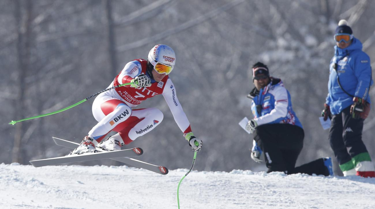 Winner Switzerland's Carlo Janka is airborne during a men's World Cup super-G race, also a test event of the Pyeongchang 2018 Winter Olympics, at the Jeongseon Alpine Centre in Jeongseon, South Korea, Sunday, Feb. 7, 2016. (AP Photo/Lee Jin-man)