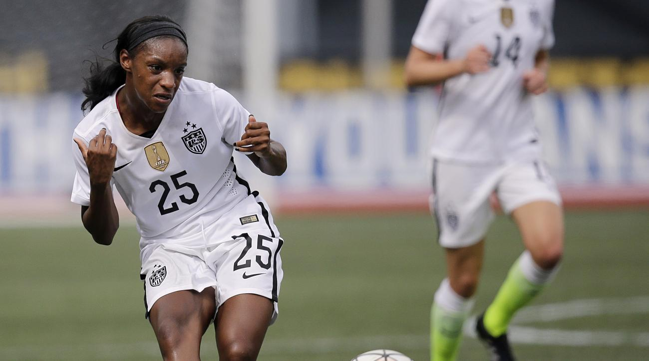 FILE - In this Sept. 20, 2015, file photo, United States' Crystal Dunn passes the ball during the US Women's World Cup victory tour against Haiti in Birmingham, Ala. Dunn is a versatile 23-year-old midfielder for the U.S. national team. She is on the cons