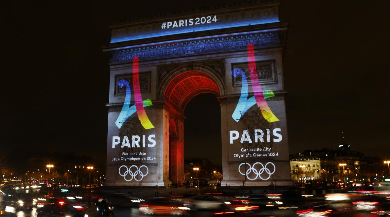 The Eiffel Tower-shaped bid logo for the Paris 2024 is unveiled on The Arc of Triomphe on the Champs Elysees in Paris, France, Tuesday, Feb. 9, 2016. Leaders of the Paris bid for the 2024 Olympics boosted their public campaign on Tuesday as they secured a