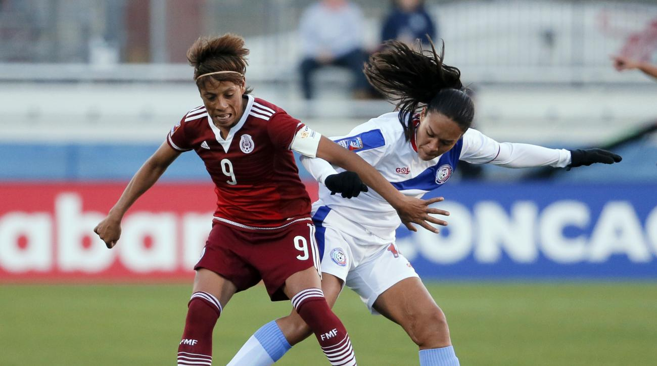 Mexico's Maribel Dominguez (9) competes against Ashley Rivera for control of the ball in the first half of a CONCACAF Olympic qualifying tournament soccer match Wednesday, Feb. 10, 2016, in Frisco, Texas. (AP Photo/Tony Gutierrez)