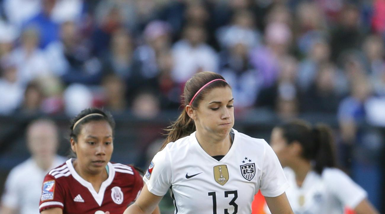 United States forward Alex Morgan (13) controls a pass in front of Mexico midfielder Karla Nieto (6) in the second half of a CONCACAF Olympic qualifying tournament soccer match, Saturday, Feb. 13, 2016, in Frisco, Texas. The U.S. won 1-0. (AP Photo/Tony G
