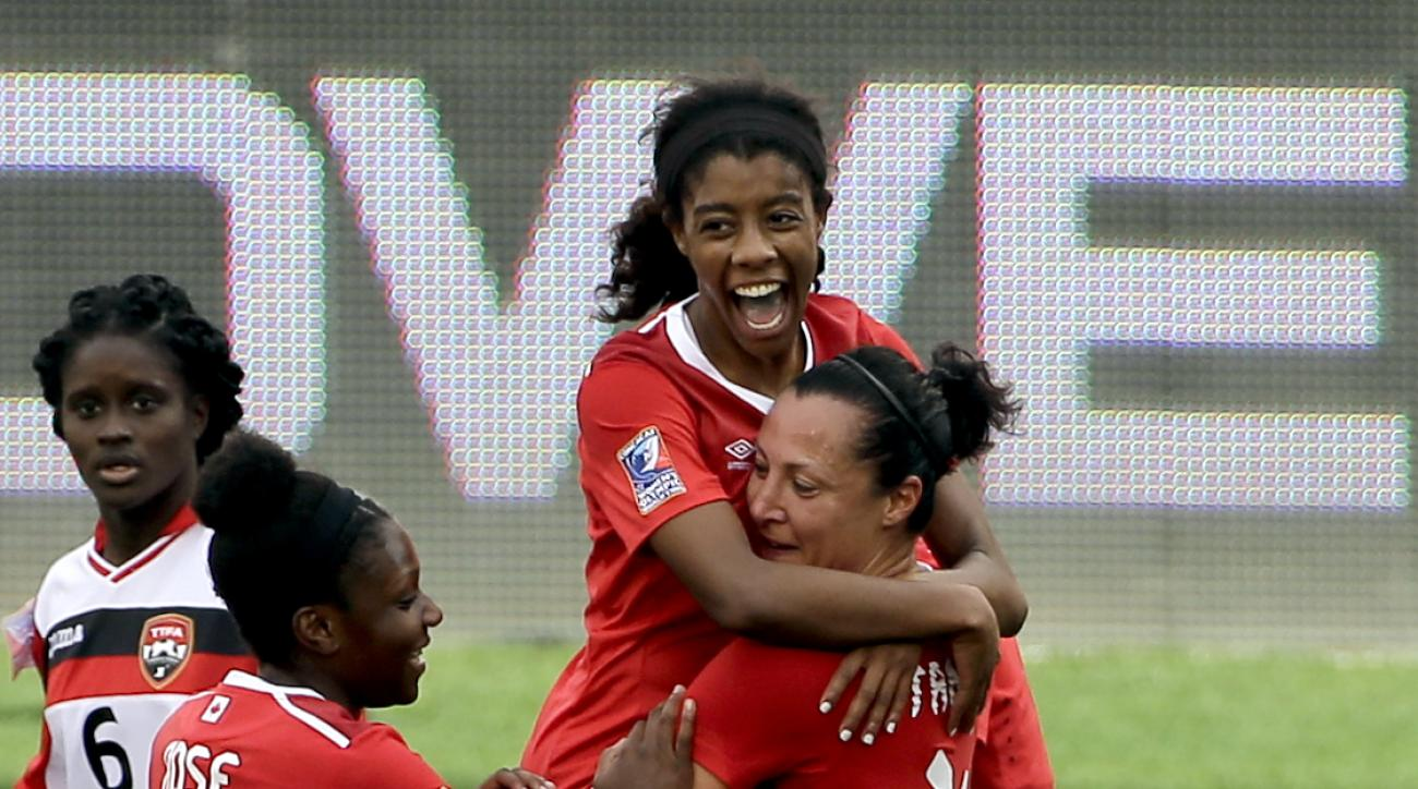 Canada's Melissa Tancredi (14) celebrates her goal while holding Ashley Lawrence as Deanne Rose (6) joins in during the first half of a CONCACAF Olympic qualifying tournament soccer match against Trinidad & Tobago Sunday, Feb. 14, 2016, in Houston. (AP Ph