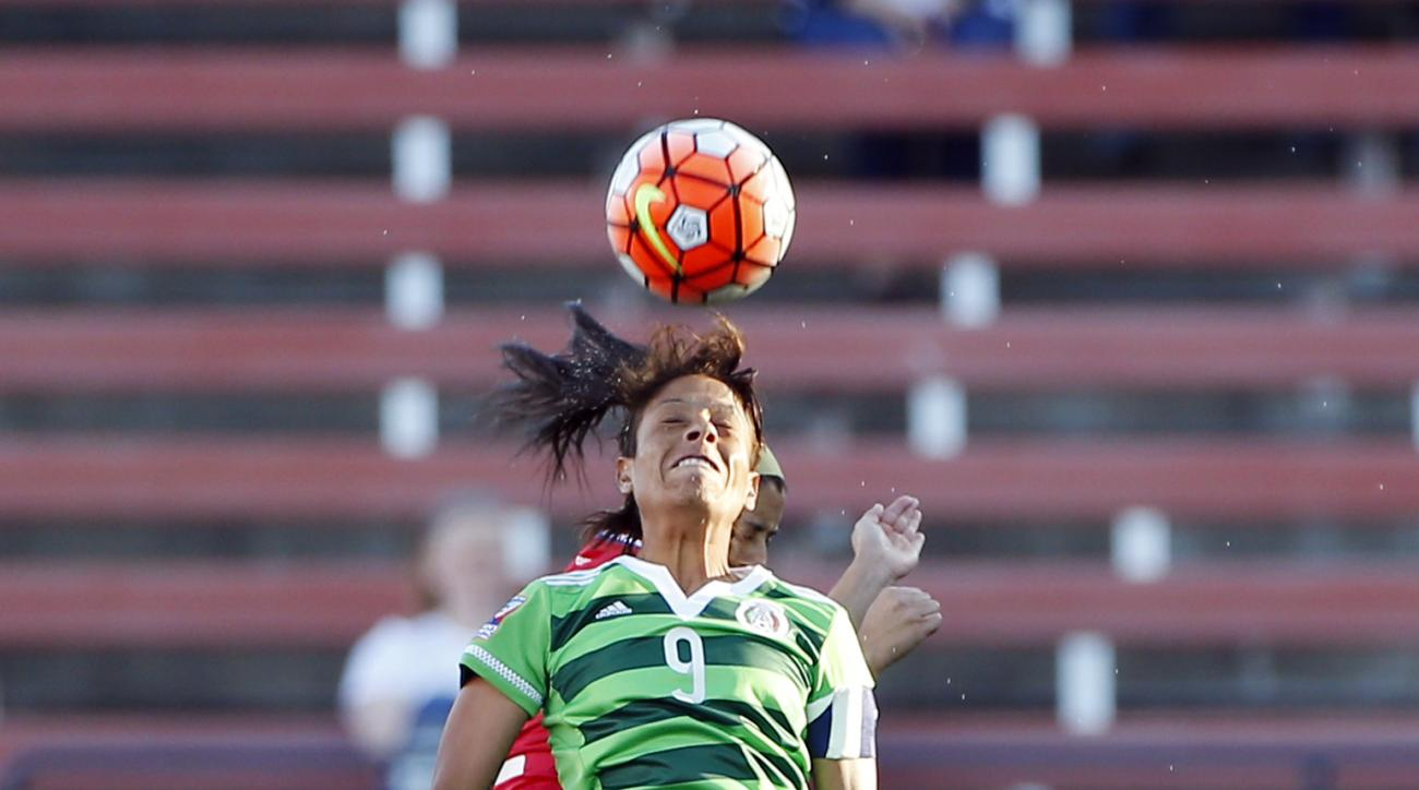 Mexico forward Maribel Dominguez Castelan (9) heads the ball as Costa Rica defender Lixy Maria Rodriguez Zamora, background, defends during the first half of a women's Olympic qualifying soccer match, Monday, Feb. 15, 2016 in Frisco, Texas. Costa Rica won