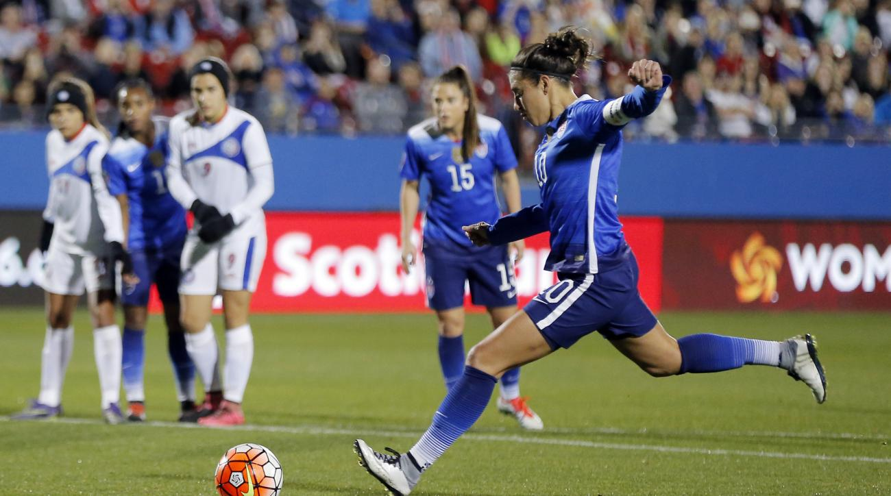 United States midfielder Carli Lloyd (10) scores on a penalty kick during the first half of a women's Olympic qualifying soccer match against Puerto Rico, Monday, Feb. 15, 2016 in Frisco, Texas. (AP Photo/Brandon Wade)