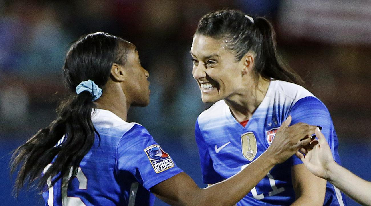 United States forward Crystal Dunn (16) is congratulated by defender Alexandra Krieger (11) after scoring a goal during the first half of a women's Olympic qualifying soccer match against Puerto Rico, Monday, Feb. 15, 2016 in Frisco, Texas. (AP Photo/Bran