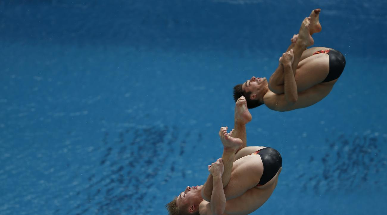 Jack Laugher, front, and Chris Mears of Great Britain dive in the men's synchronized 3 meter springboard during the FINA World Diving Cup, at the Maria Lenk Aquatics Center in Rio de Janeiro, Brazil, Friday, Feb. 19, 2016. (AP Photo/Leo Correa)