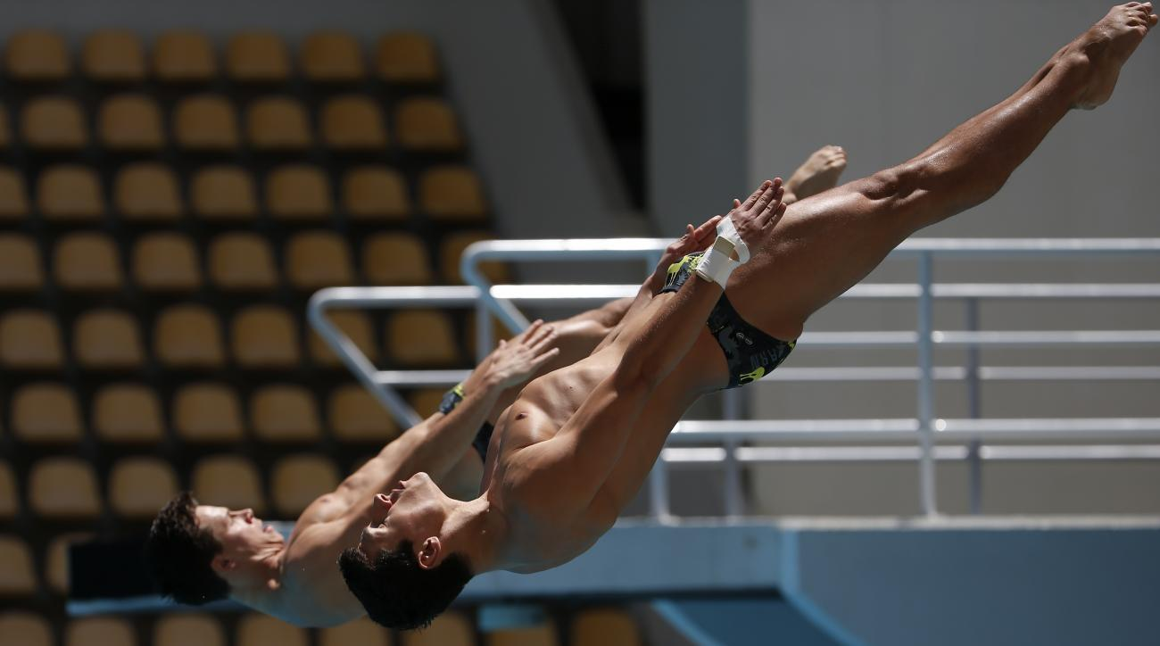 Stephan Feck and Patrick Hausding from Germany dive in the men's synchronized 3 meter springboard during the FINA World Diving Cup, at the Maria Lenk Aquatics Center in Rio de Janeiro, Brazil, Friday, Feb. 19, 2016. (AP Photo/Leo Correa)