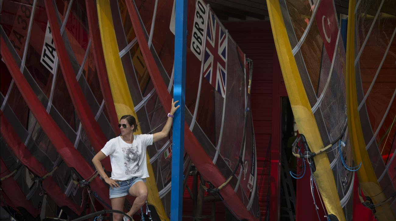 Marina Alabau, a Spanish windsurfer and a gold medalist at London Olympics, stands by her surf borads in Eliat, Israel, Friday, Feb. 19, 2016 as she prepares for the RS:X World Championship. Alabau said she got Zika while training in Brazil in December, m