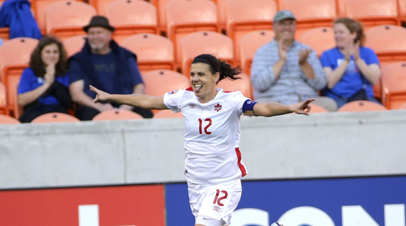 Canada's Christine Sinclair (12) celebrates after scoring a goal against Costa Rica during the first half of a CONCACAF Olympic women's soccer qualifying championship semifinal Friday, Feb. 19, 2016, in Houston. (AP Photo/David J. Phillip)