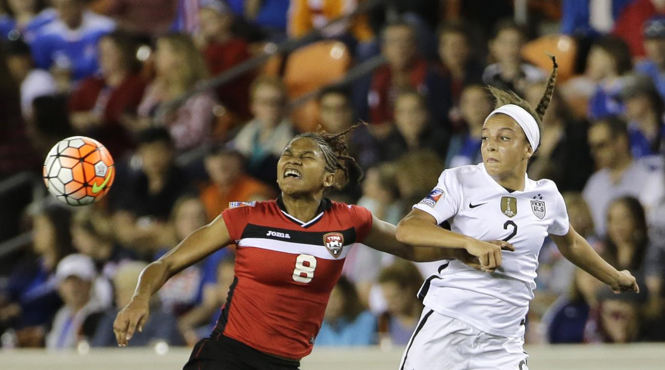 In this photo taken Friday, Feb. 19, 2016, Trinidad and Tobago's Victoria Swift (8) and United States' Mallory Pugh (2) go up for the ball during the first half of a CONCACAF Olympic qualifying tournament semifinal soccer game in Houston. Pugh is just 17