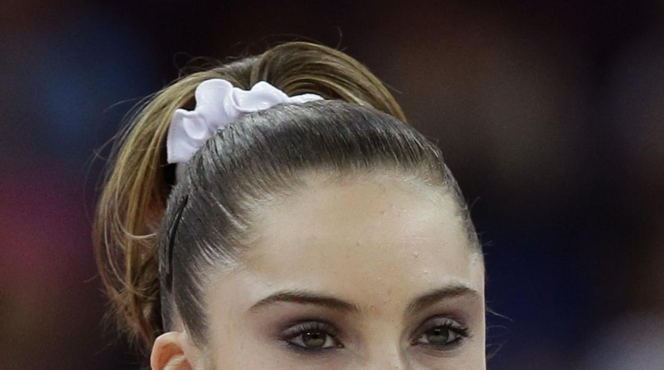 FILE - This Aug. 5, 2012,  file photo shows U.S. silver medal gymnast McKayla Maroney during the podium ceremony for the artistic gymnastics women's vault finals at the 2012 Summer Olympics in London. Her peeved expression on the medal stand after slippin