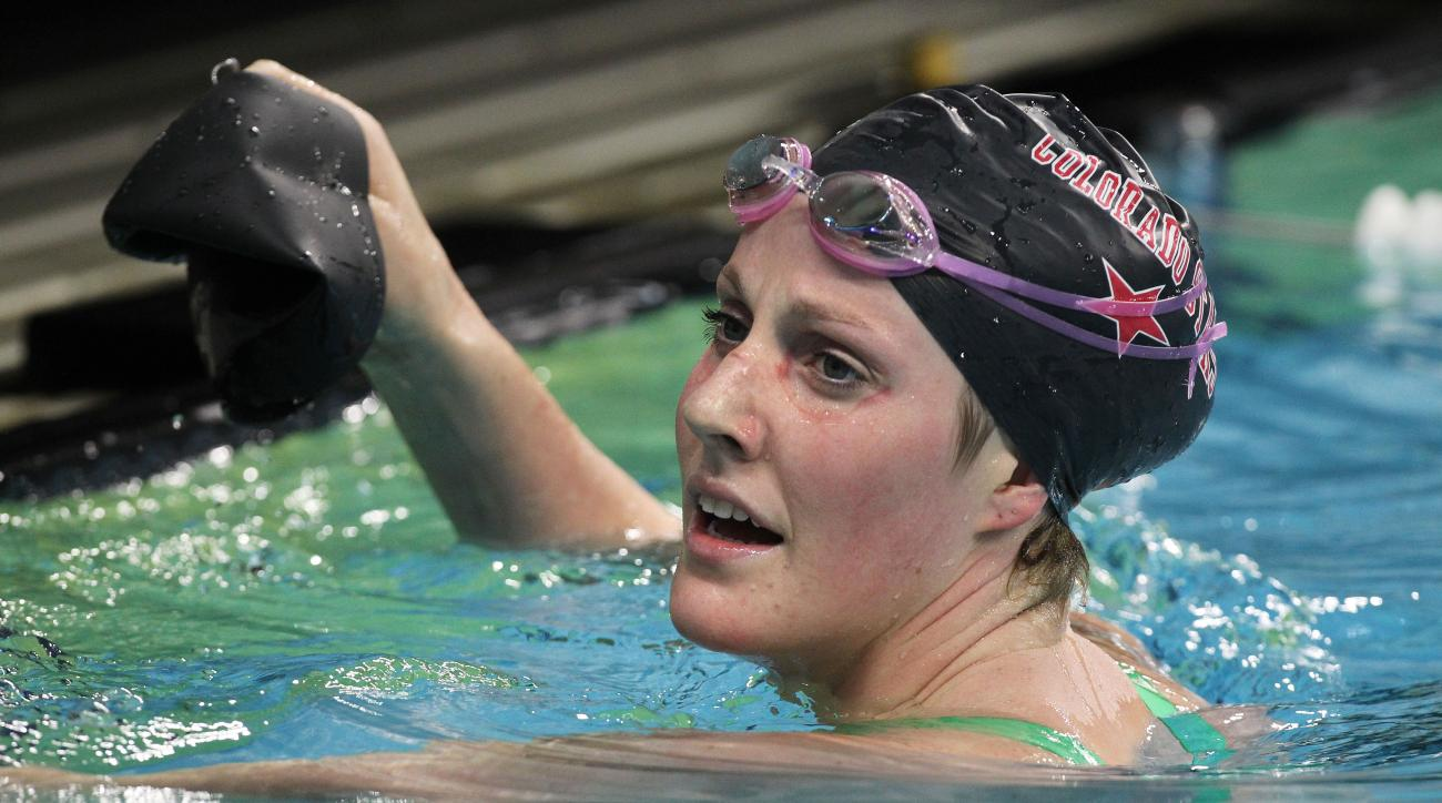 FILE - In this Jan. 16, 2016, file photo, Missy Franklin watches the results board of the women's 200-meter backstroke during the Arena Pro Swim Series, in Austin, Texas. The Olympic champion with the perpetual smile concedes that subpar performances over