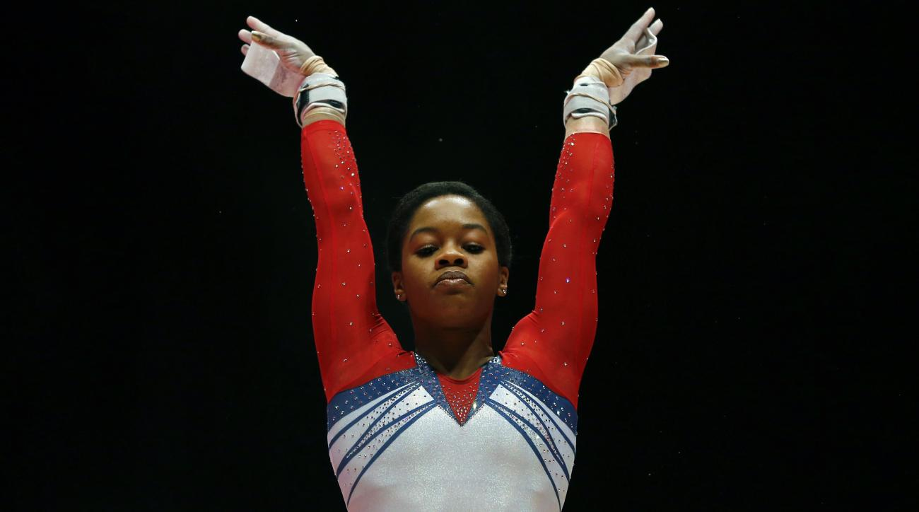 FILe - In this Oct. 31, 2015, file photo, Gabby Douglas of the U.S. performs on the uneven bars during the women's apparatus final competition at the World Artistic Gymnastics championships at the SSE Hydro Arena in Glasgow, Scotland. The 2012 Olympic all