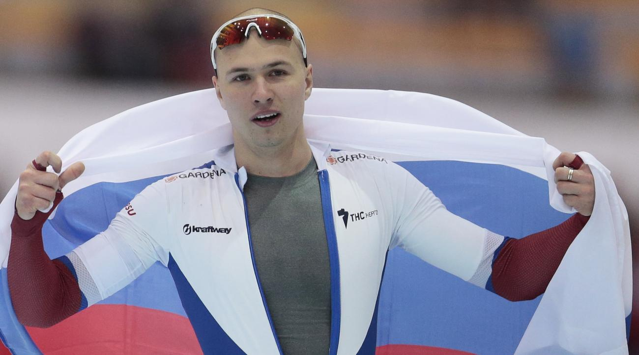 FILE  In this file photo taken on Sunday, Feb.  14, 2016, Russia's Pavel Kulizhnikov reacts after winning the men's 500 meter race of the speedskating single distance World Championships in Kolomna, Russia. World champion Russian speedskater Pavel Kulizhn