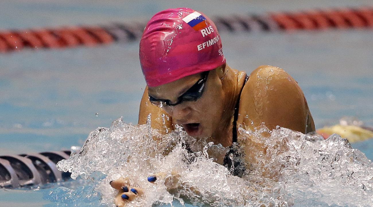 FILE - In this Dec. 4, 2015, file photo, Yulia Efimova swims in the women's 100-meter breaststroke during a preliminary race in the U.S. Winter Nationals swimming event in Federal Way, Wash. World champion Efimova has been provisionally suspended on suspi