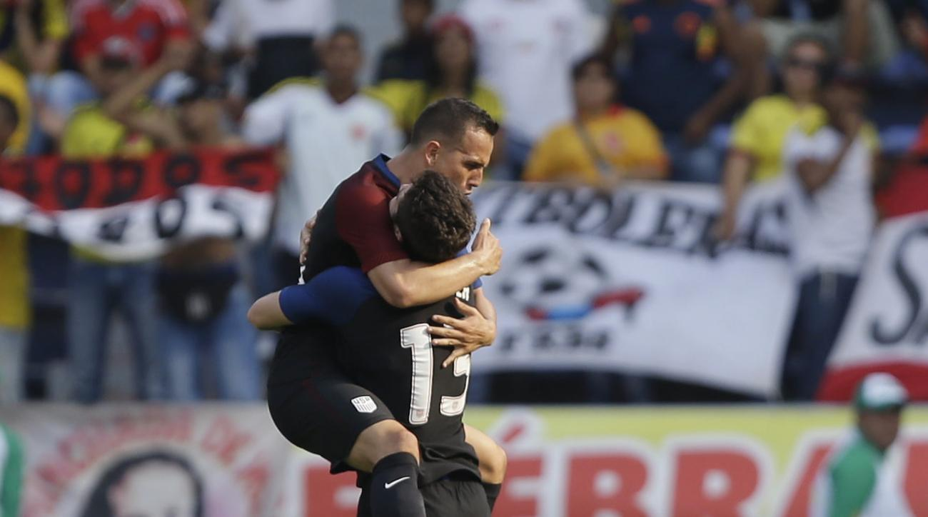 United States' Luis Gil, left, is embraced by teammate Matt Polster after scoring his side's first goal against Colombia  during a U-23 first leg soccer match qualifier for the 2016 Rio Olympics at the Roberto Melendez Stadium in Barranquilla, Colombia, F