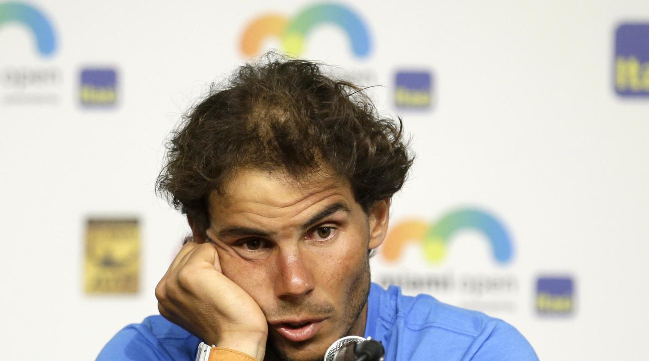 Rafael Nadal, of Spain, talks to reporters during a news conference at the Miami Open tennis tournament in Key Biscayne, Fla., Saturday, March 26, 2016. Nadal faded in the subtropical heat and retired after falling behind in the third set of his opening m
