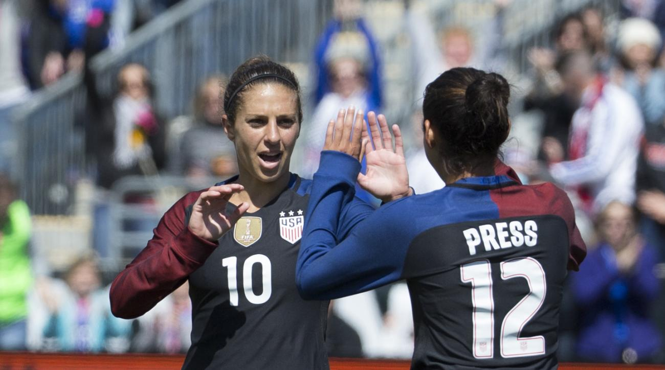 United States' Carli Lloyd (10) celebrates Christen Press's goal during the first half of an international friendly soccer match against Colombia, Sunday, April 10, 2016, in Chester, Pa. (AP Photo/Chris Szagola)